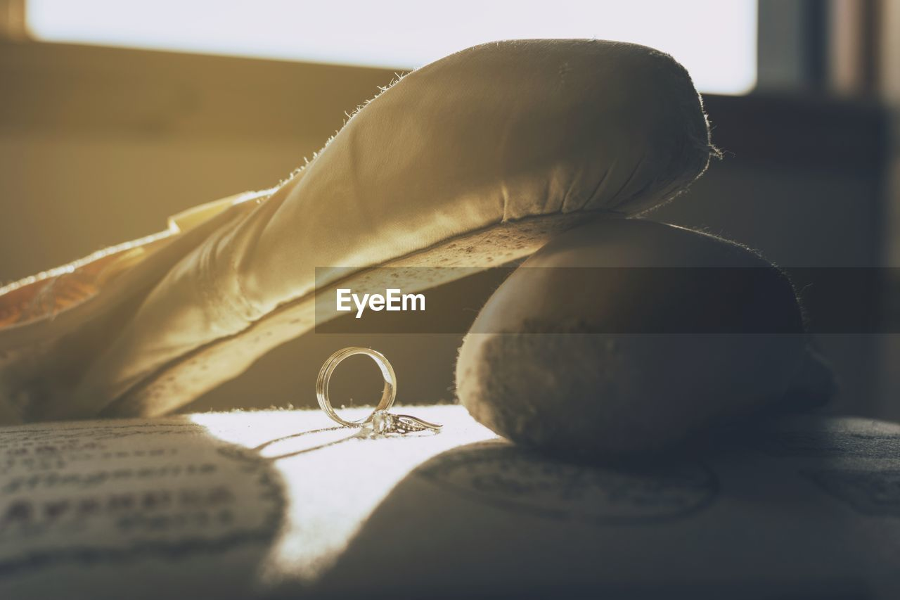 Close-up of rings and shoes on table