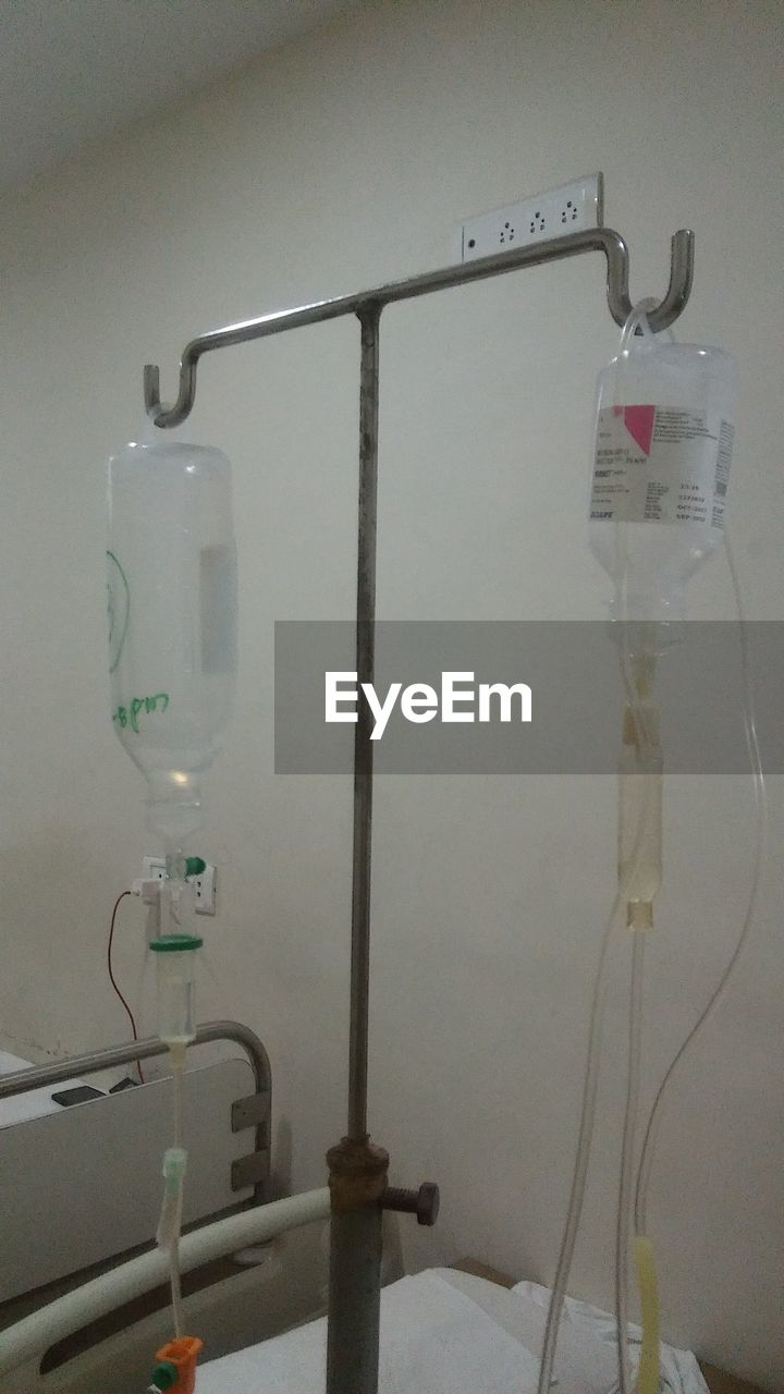 healthcare and medicine, indoors, hospital, no people, close-up, group of objects, wall - building feature, iv drip, hanging, electricity, medical equipment, equipment, illuminated, metal, fuel and power generation, pipe - tube, technology, medical clinic, cable, group, electrical equipment