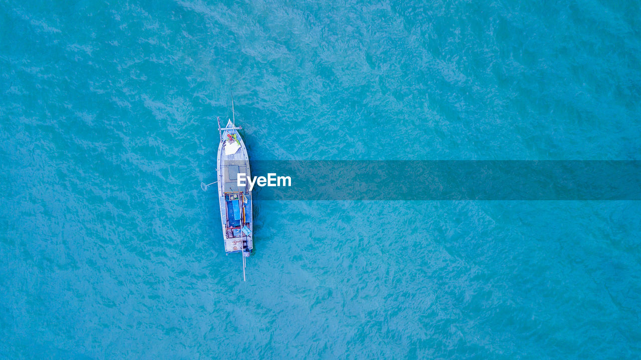 nautical vessel, high angle view, directly above, water, day, sea, blue, nature, aerial view, no people, transportation, outdoors, mode of transportation, travel, copy space, summer, trip, vacations, turquoise colored, above, leaving, luxury