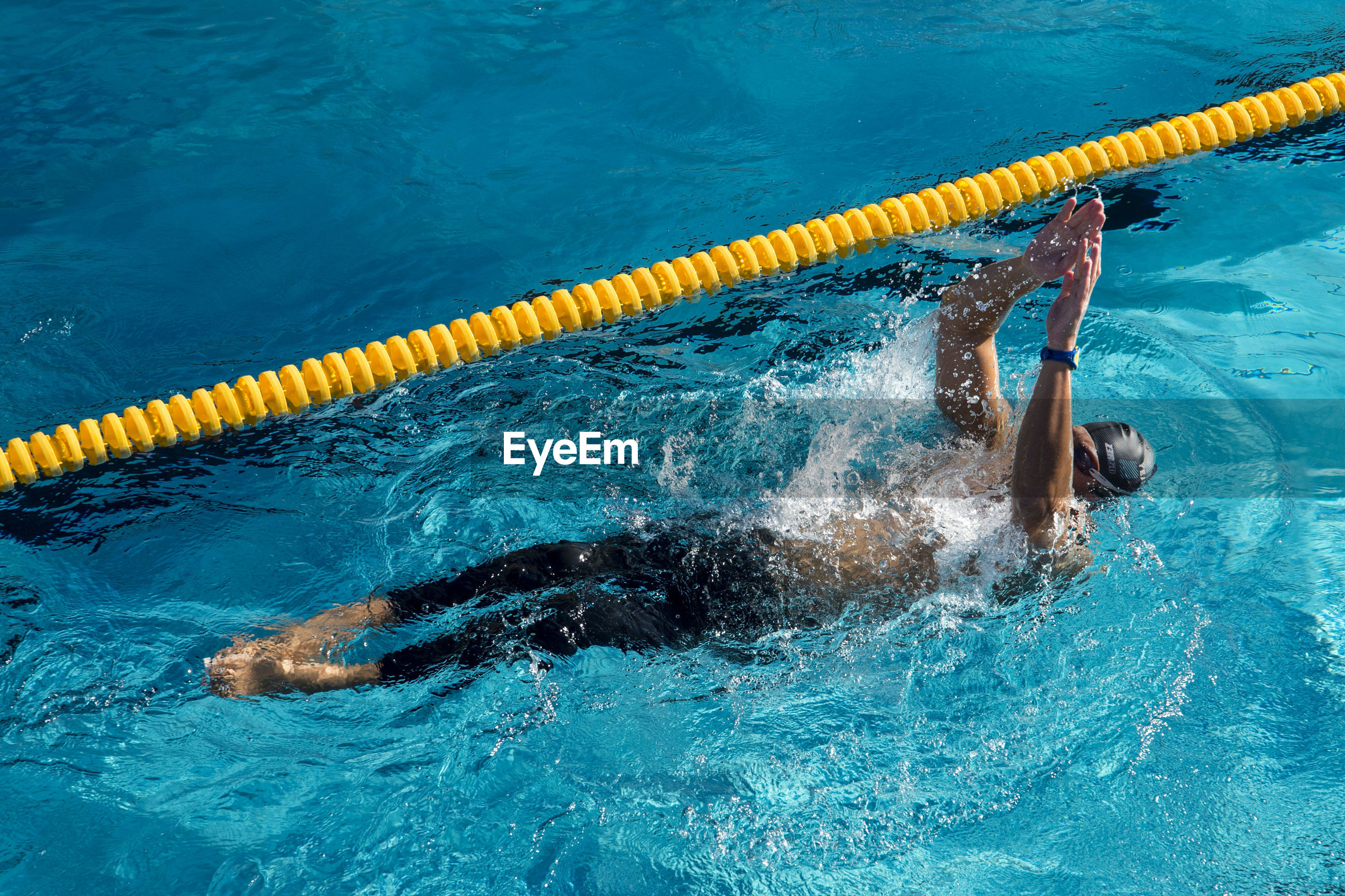 HIGH ANGLE VIEW OF SWIMMING UNDERWATER IN POOL