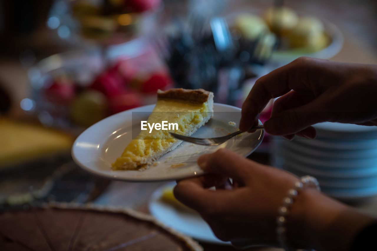 human hand, hand, food and drink, food, human body part, one person, real people, holding, selective focus, indoors, lifestyles, freshness, sweet, plate, sweet food, ready-to-eat, dessert, table, women, finger, temptation, breakfast