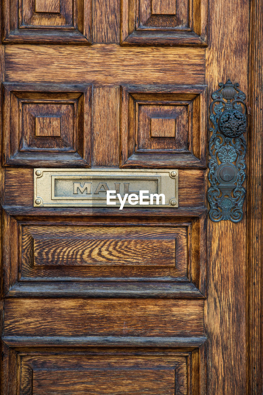wood - material, door, entrance, no people, drawer, pattern, communication, close-up, text, full frame, backgrounds, architecture, brown, closed, old, furniture, protection, handle, filing cabinet, antique