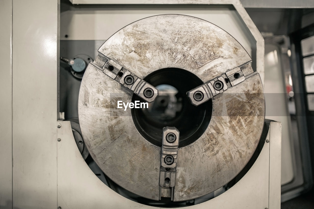 metal, close-up, indoors, circle, shape, geometric shape, no people, bathroom, focus on foreground, technology, machinery, equipment, domestic room, design, machine part, communication, mirror, silver colored, home, sign, electrical equipment