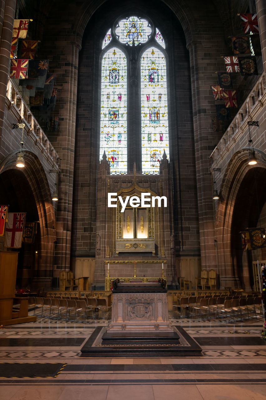 place of worship, religion, spirituality, belief, architecture, built structure, arch, indoors, building, stained glass, window, glass, no people, glass - material, human representation, altar