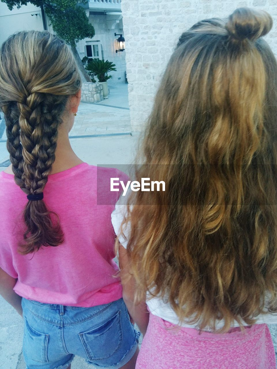 women, hair, hairstyle, rear view, females, girls, child, real people, casual clothing, lifestyles, adult, two people, long hair, leisure activity, people, family, childhood, standing, togetherness, day, pink color, human hair, daughter, teenager, innocence, sister