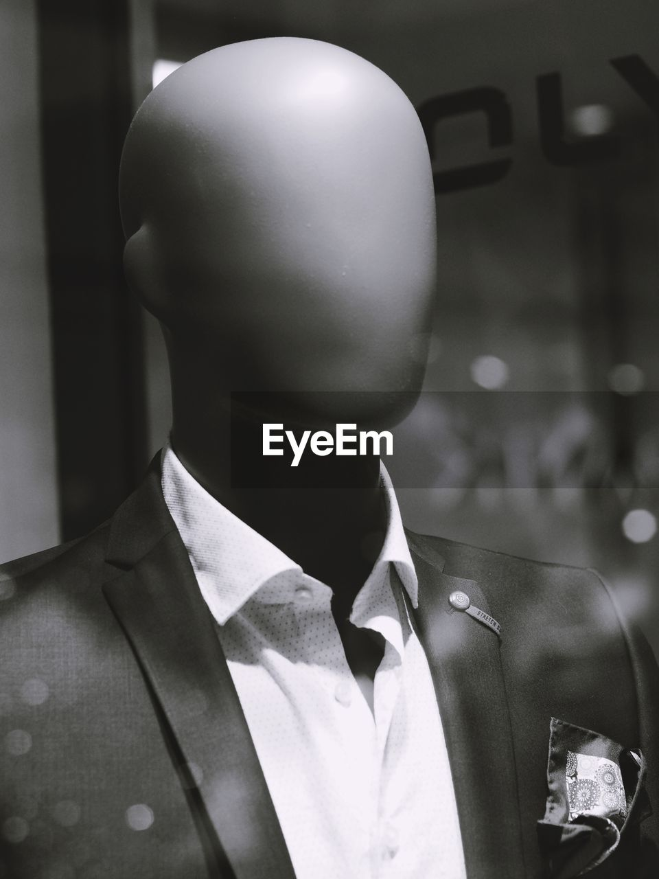 clothing, one person, mannequin, focus on foreground, human representation, men, headshot, indoors, business, portrait, representation, necktie, retail display, suit, real people, male likeness, well-dressed, close-up, menswear, uniform