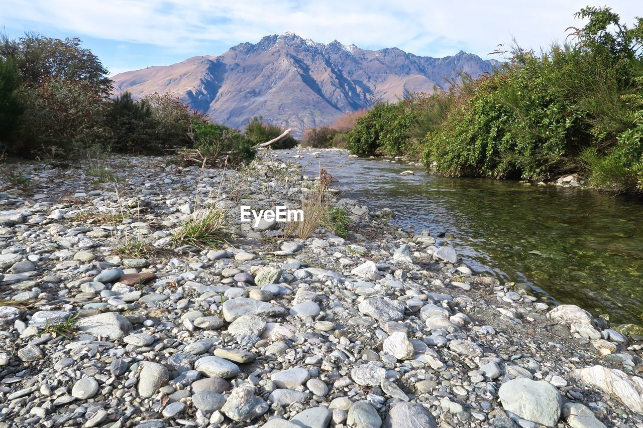 nature, water, mountain, tranquility, tranquil scene, river, day, tree, beauty in nature, outdoors, scenics, no people, landscape, mountain range, sky