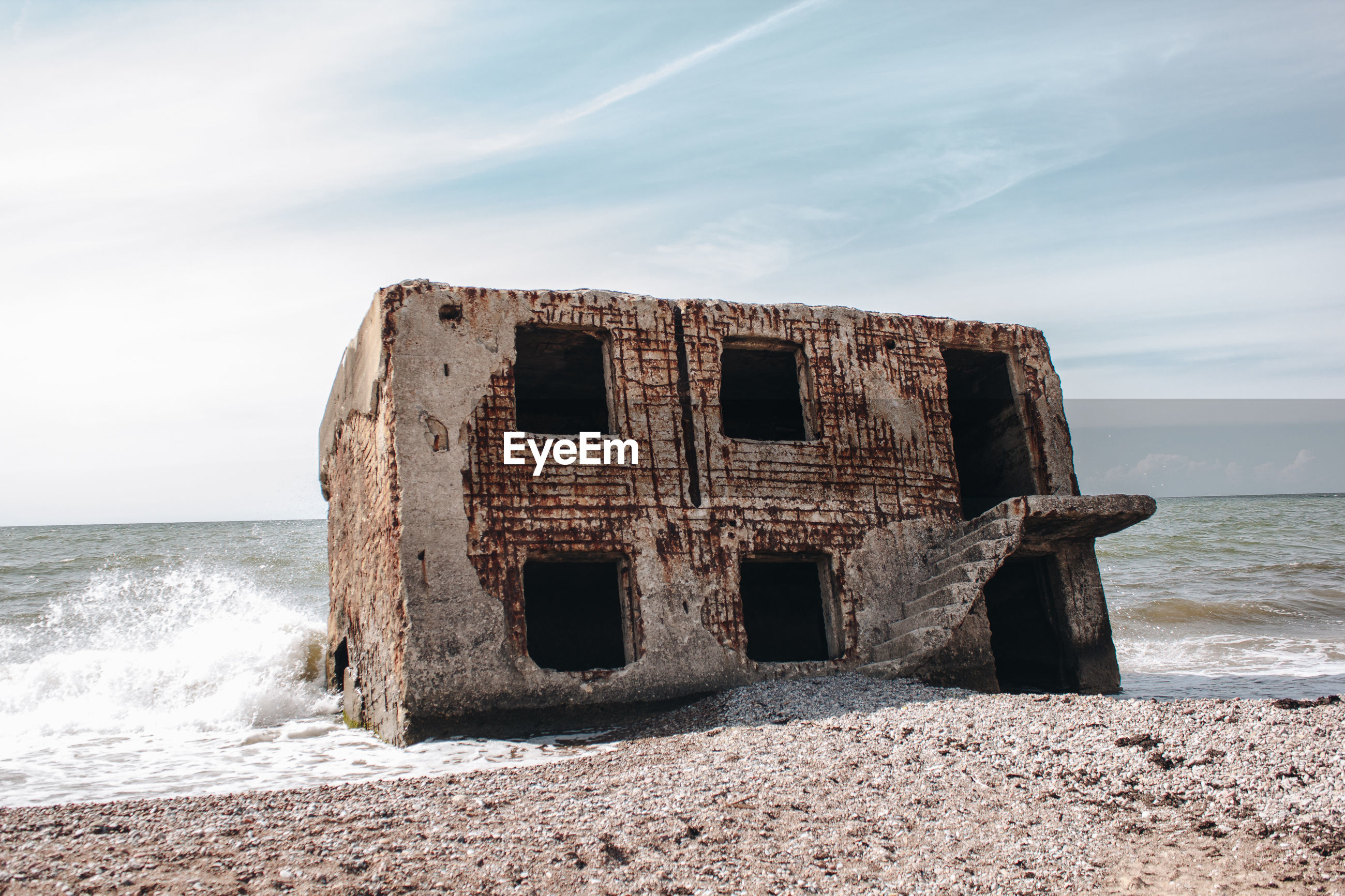 ABANDONED BUILT STRUCTURE ON BEACH