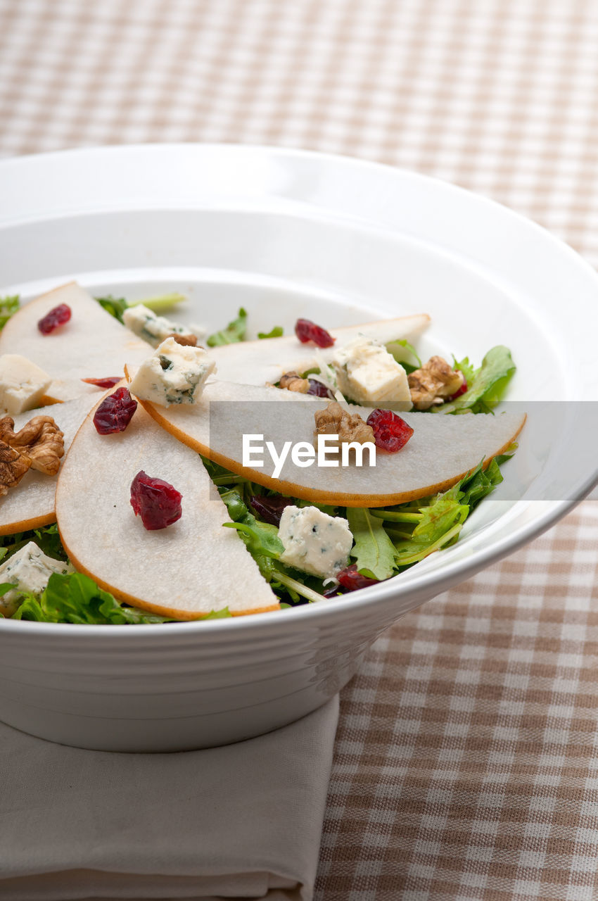 Close-Up Of Salad In Bowl Served On Table