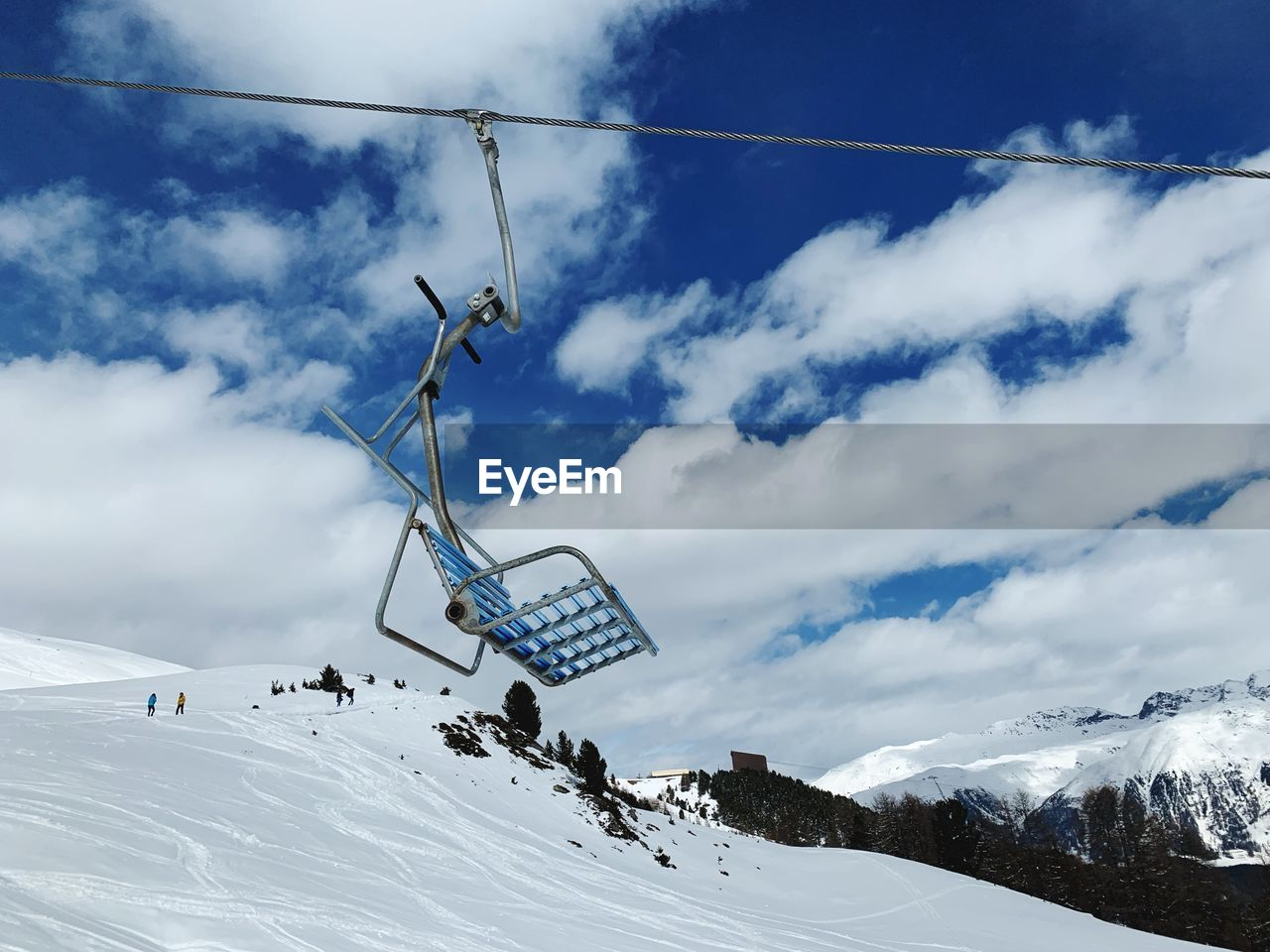 winter, cold temperature, snow, cloud - sky, sky, mountain, scenics - nature, cable car, beauty in nature, day, ski lift, tranquil scene, nature, white color, environment, snowcapped mountain, overhead cable car, sport, tranquility, mountain range, no people, outdoors, ski resort