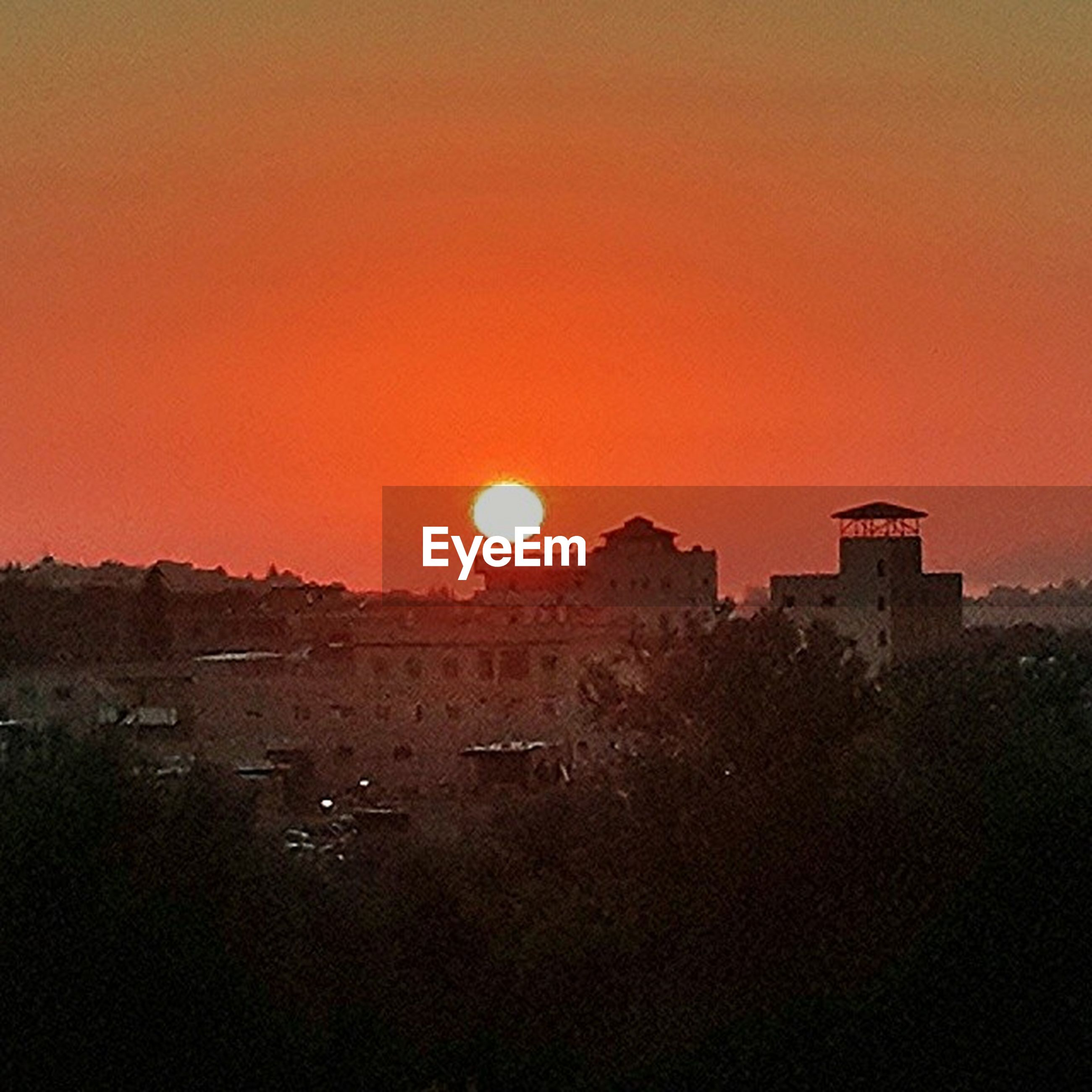 sunset, orange color, sun, copy space, clear sky, scenics, silhouette, beauty in nature, tranquil scene, tranquility, built structure, sky, building exterior, nature, architecture, idyllic, landscape, outdoors, no people, sunlight