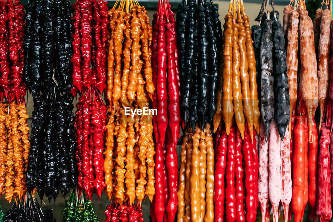 CLOSE-UP OF MULTI COLORED SALE AT MARKET STALL