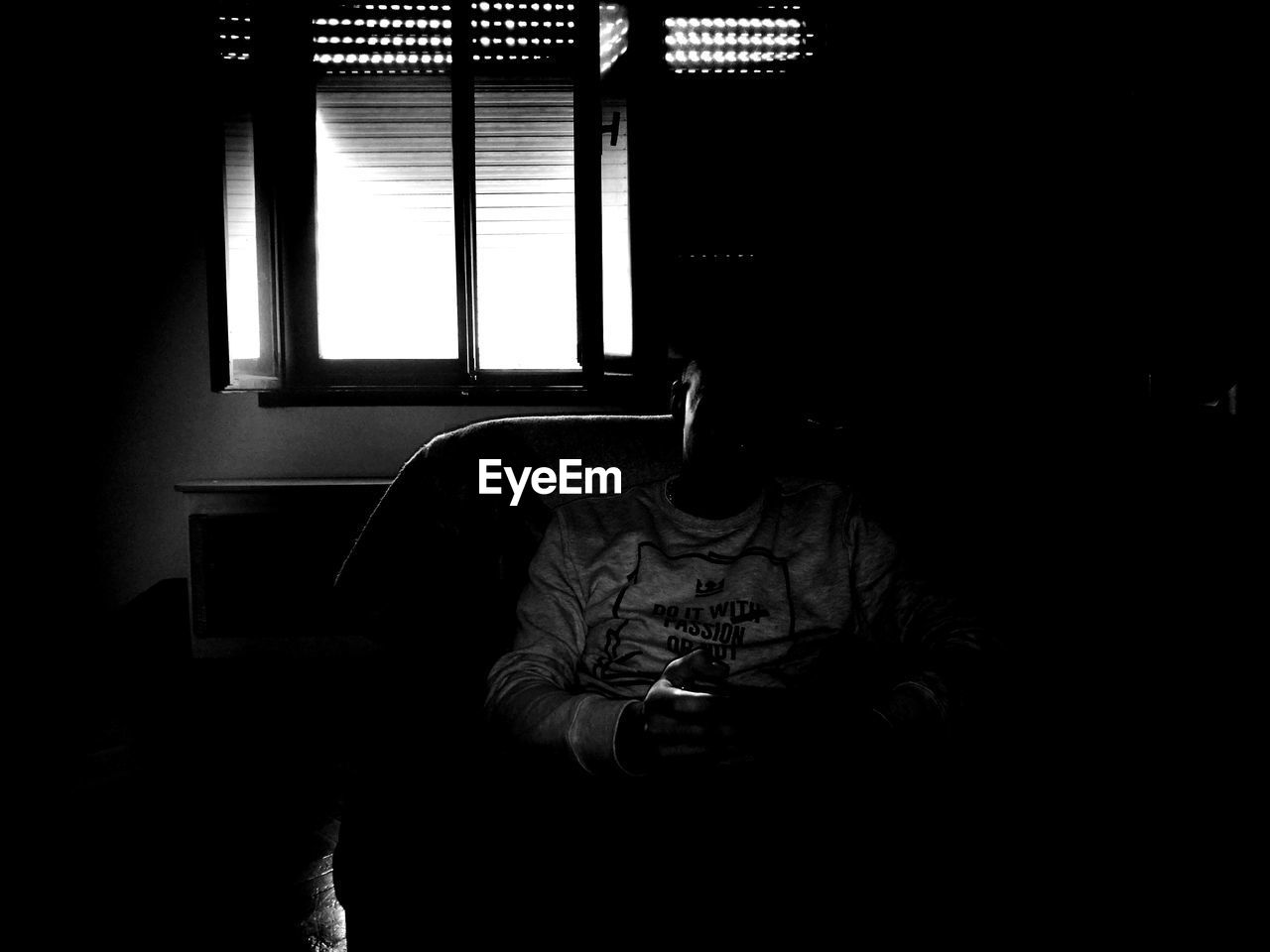 indoors, dark, window, one person, sitting, home interior, real people, men, technology, young adult, day, people