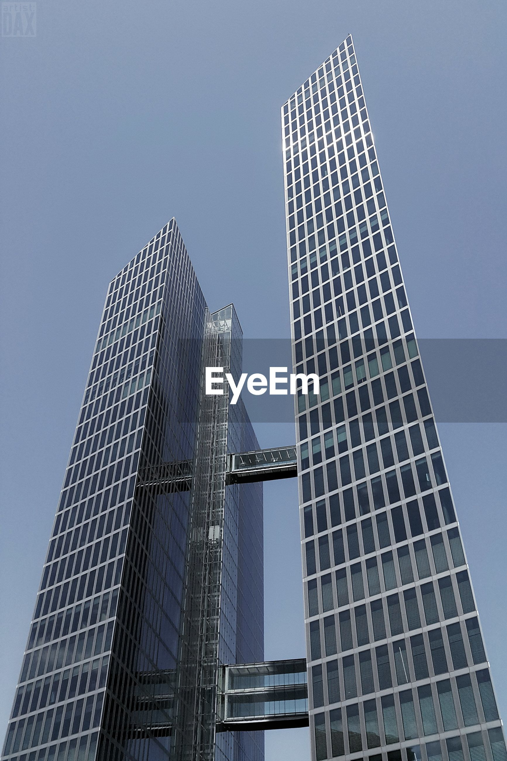 skyscraper, modern, architecture, tall - high, low angle view, tower, built structure, clear sky, tall, building exterior, day, travel destinations, city, outdoors, no people, blue, sky