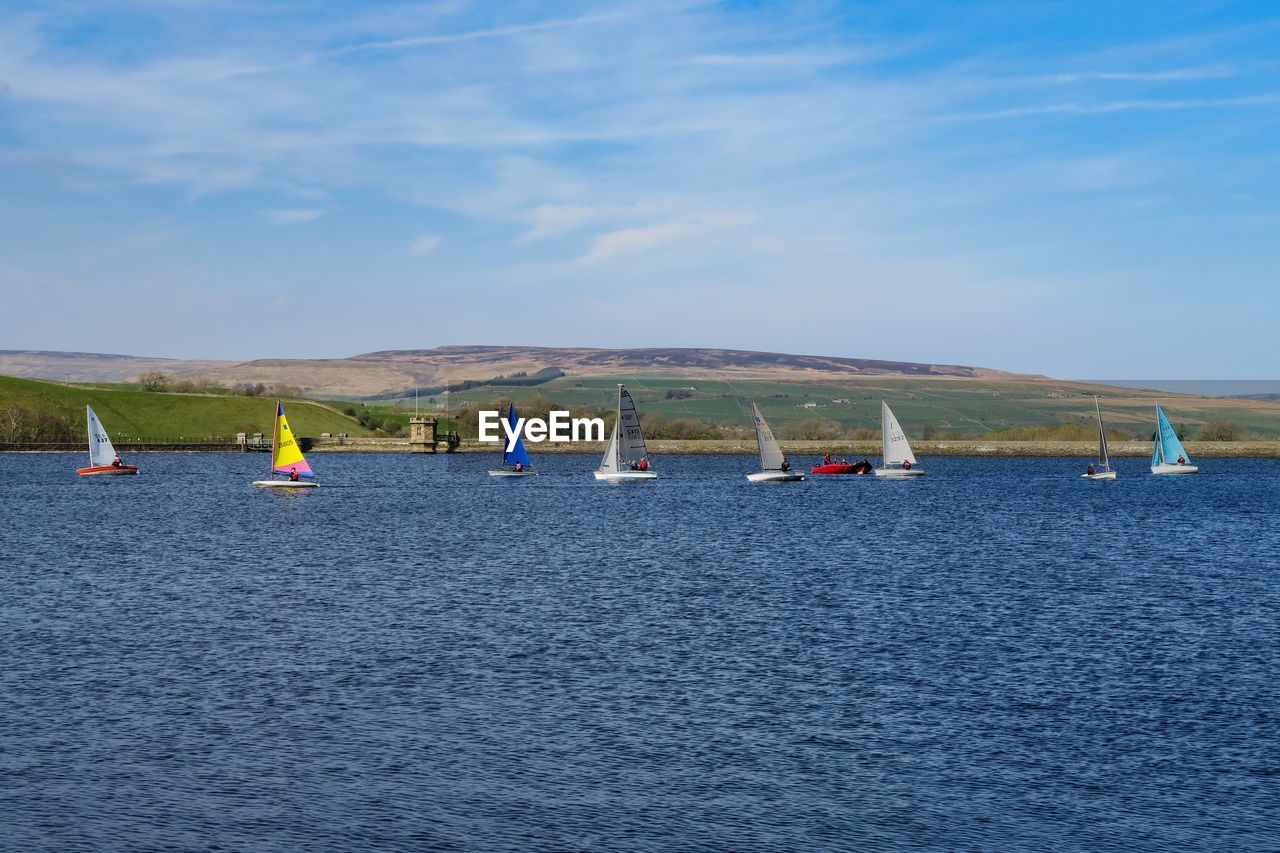 water, waterfront, transportation, sky, nautical vessel, sea, mode of transportation, day, scenics - nature, cloud - sky, beauty in nature, nature, tranquil scene, sailboat, rippled, tranquility, outdoors, non-urban scene, blue