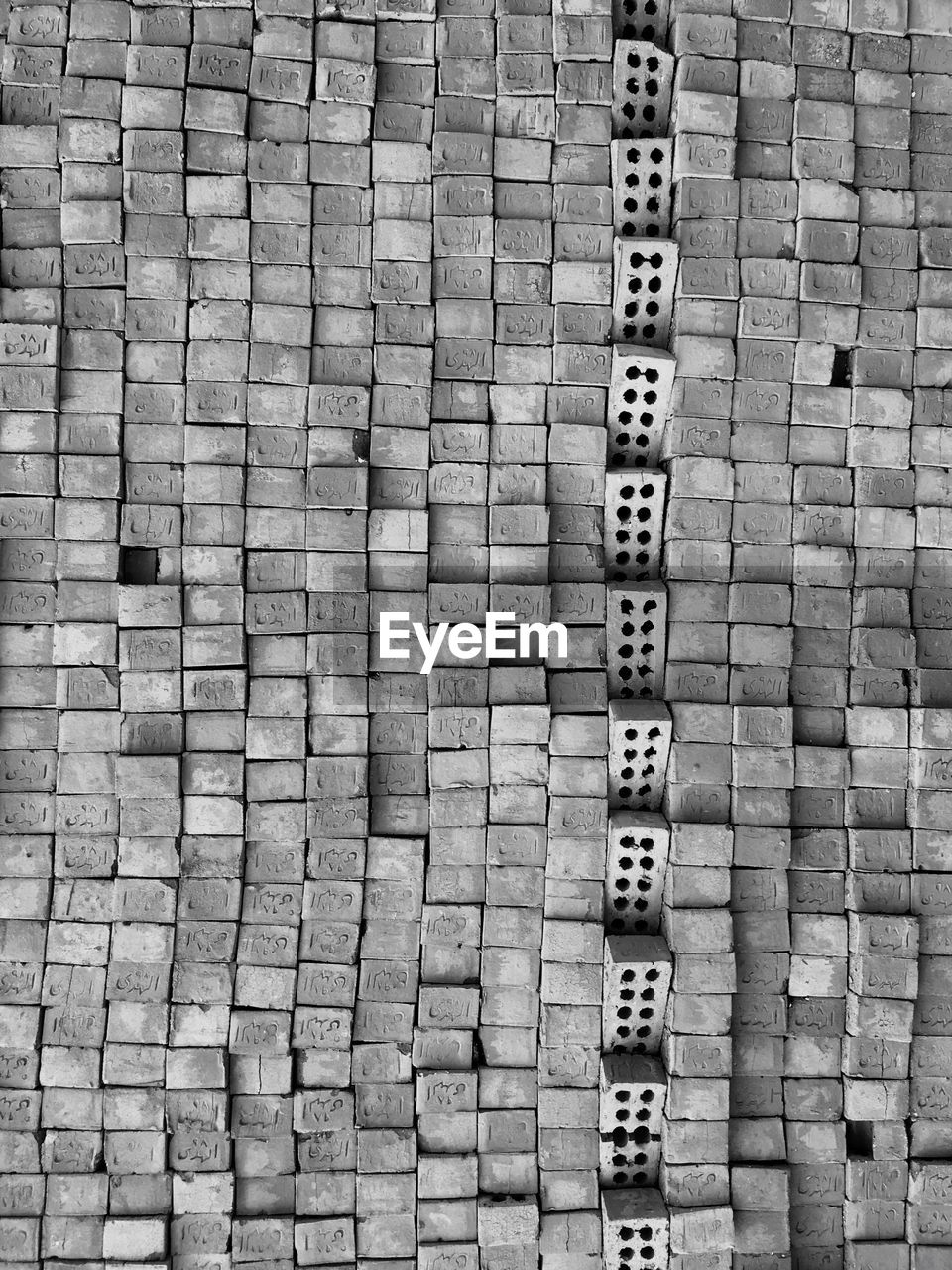 pattern, full frame, backgrounds, no people, day, in a row, arrangement, high angle view, architecture, outdoors, repetition, built structure, design, wall, textured, side by side, wall - building feature, order, footpath, sunlight