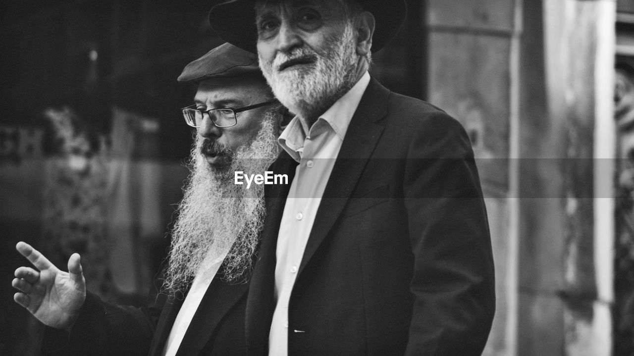 one person, males, men, beard, facial hair, real people, adult, waist up, focus on foreground, clothing, business, front view, standing, smoking issues, cigarette, lifestyles, mid adult men, looking, mature men, contemplation