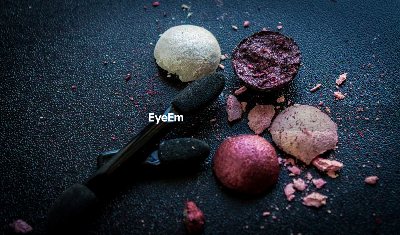 Crushed Eyeshadows And Brushes On Table