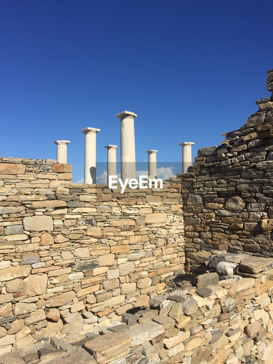sky, clear sky, architecture, the past, built structure, history, day, ancient civilization, no people, nature, ancient, blue, copy space, sunlight, architectural column, travel destinations, tourism, building exterior, solid, travel, outdoors, stone wall, archaeology, ruined