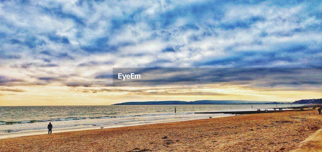 sea, water, land, beach, sky, cloud - sky, beauty in nature, scenics - nature, tranquility, sand, nature, tranquil scene, horizon, horizon over water, sunset, real people, incidental people, holiday, lifestyles, outdoors