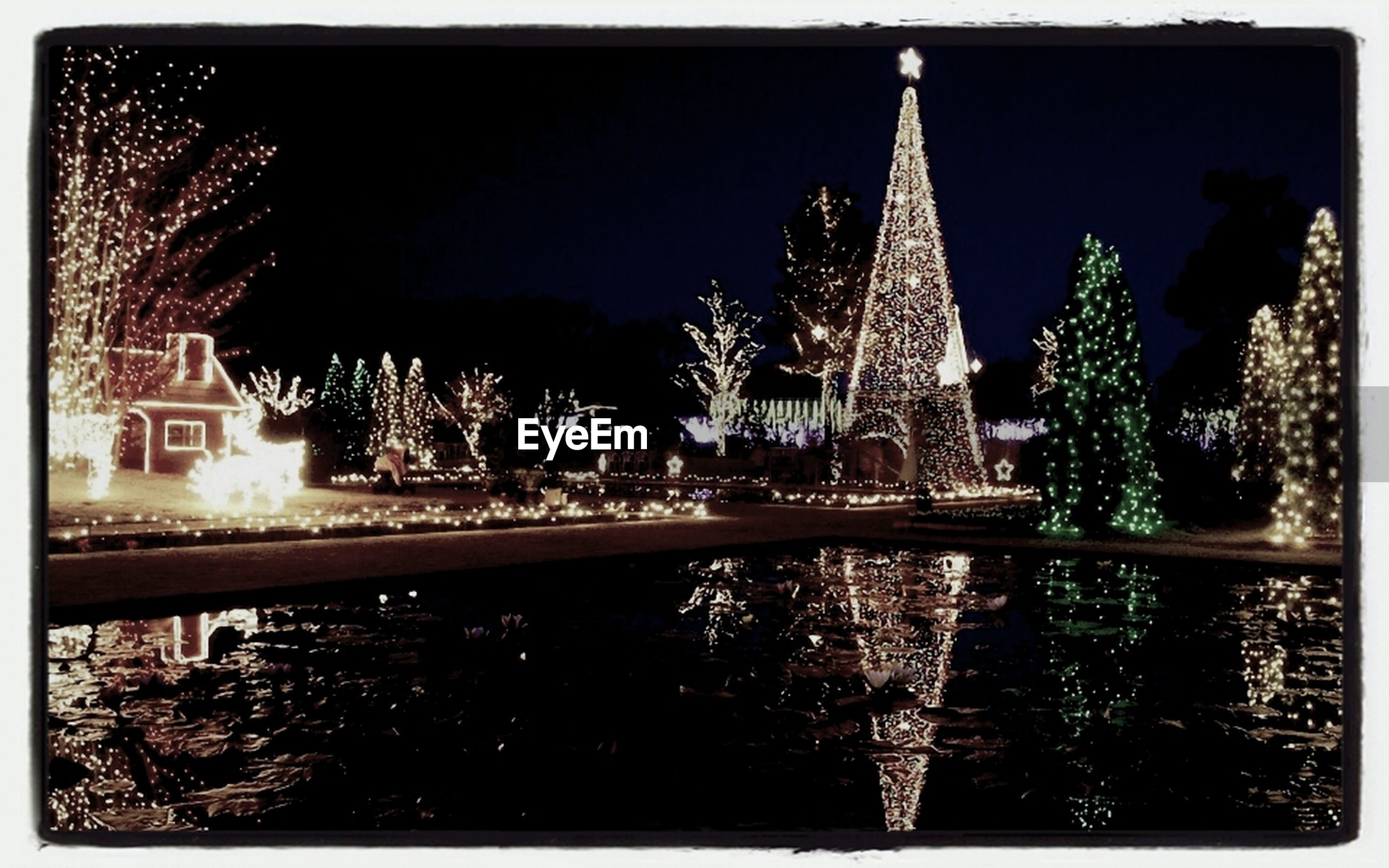 transfer print, architecture, built structure, water, building exterior, illuminated, night, tree, reflection, auto post production filter, waterfront, sky, river, city, lake, outdoors, no people, pond, fountain, nature