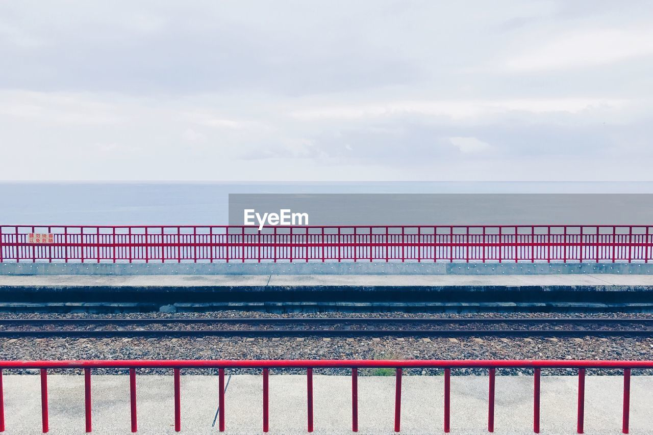 sea, railing, water, sky, horizon over water, nature, day, outdoors, no people, cloud - sky, scenics, beauty in nature