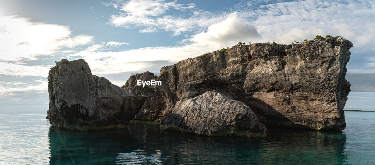 water, sky, sea, beauty in nature, tranquility, scenics - nature, tranquil scene, cloud - sky, waterfront, rock, nature, rock formation, idyllic, no people, non-urban scene, cliff, rock - object, land, solid, outdoors, stack rock, eroded, formation