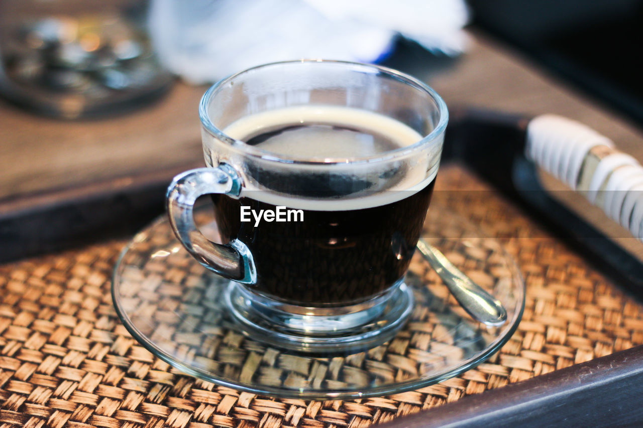Close-Up Of Cup Of Black Coffee Served In Glass Cup