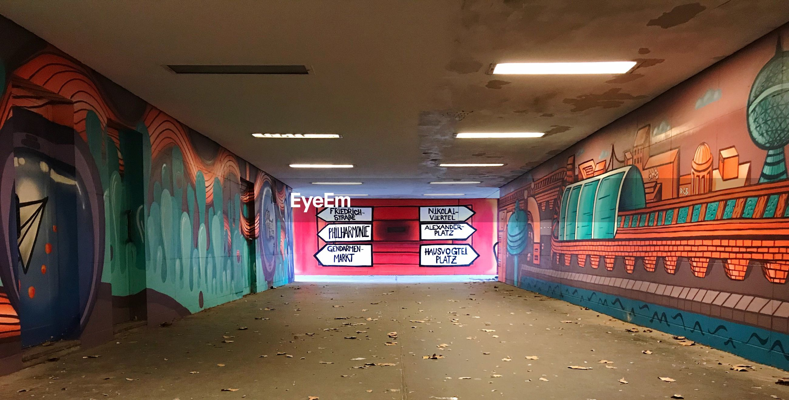 GRAFFITI ON ILLUMINATED TUNNEL