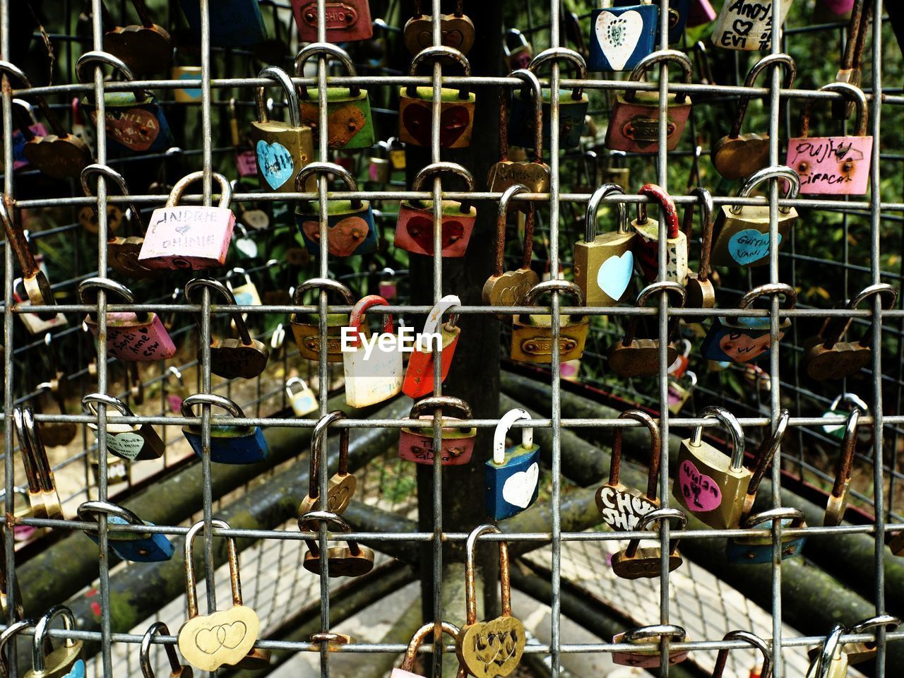 large group of objects, variation, hanging, metal, abundance, no people, choice, outdoors, padlock, day, retail, close-up, love lock