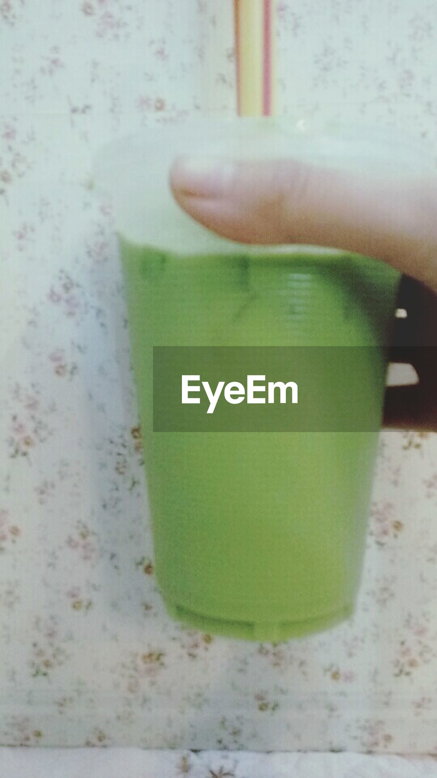 close-up, part of, green color, cropped, indoors, focus on foreground, water, table, day, person, still life, refreshment, high angle view, single object, freshness, drink
