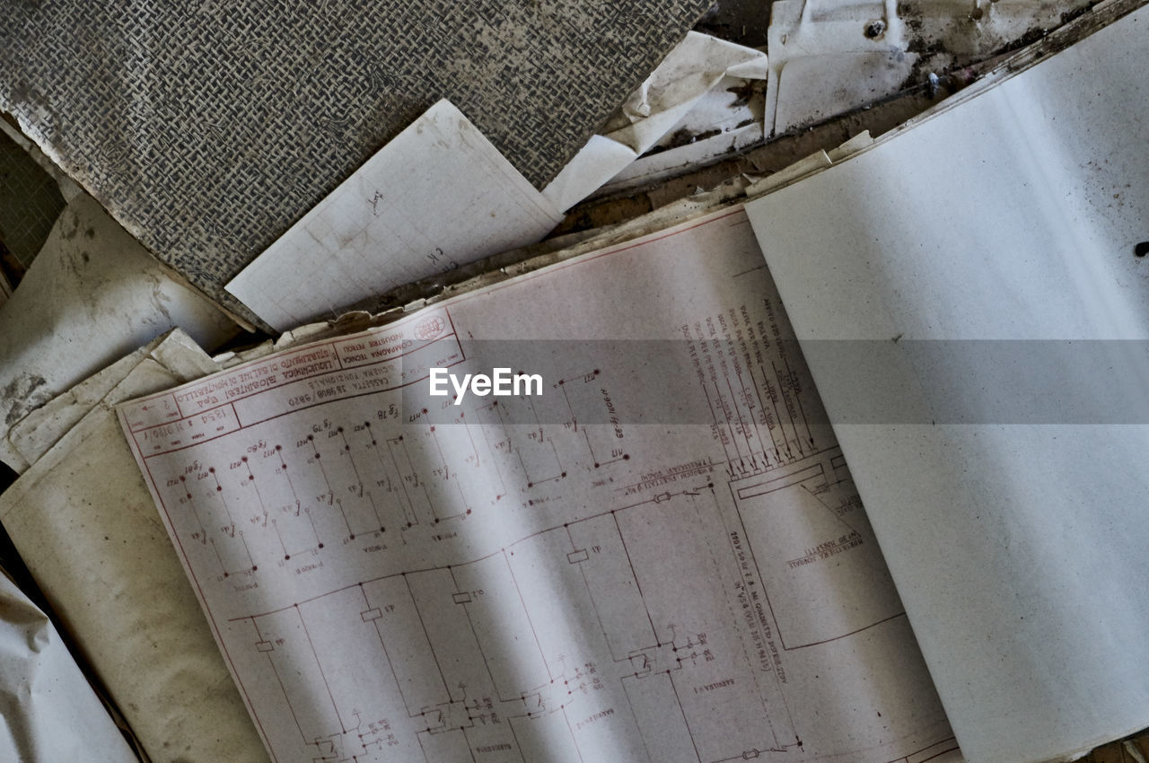 High angle view of old damaged books