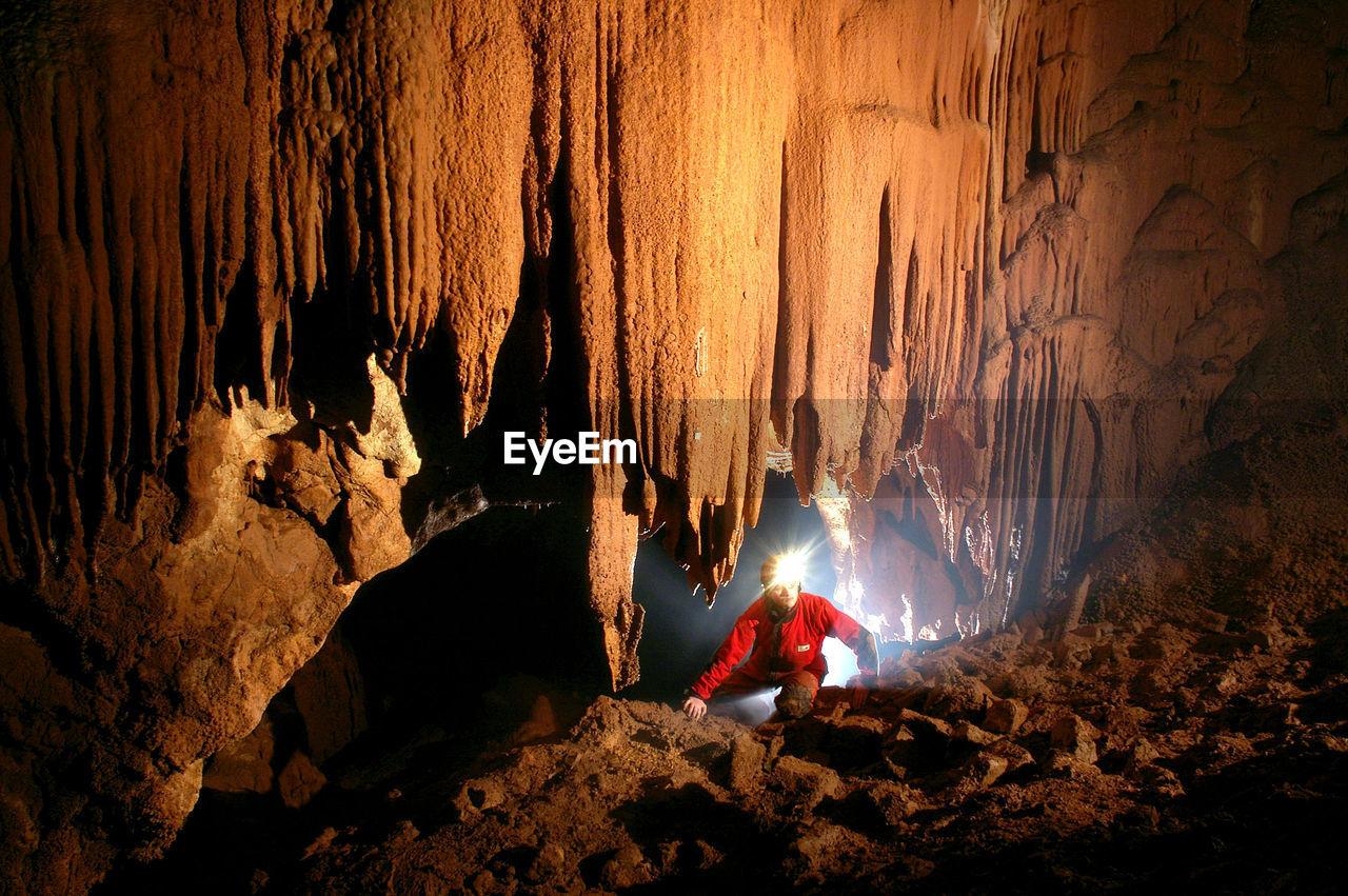 Woman In Illuminated Cave