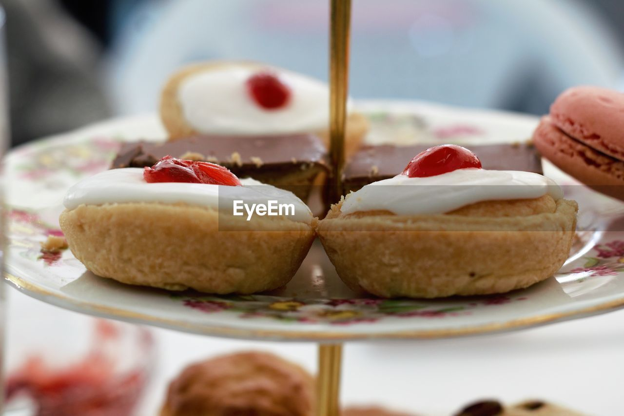 food and drink, food, sweet food, sweet, dessert, indulgence, freshness, close-up, plate, indoors, temptation, ready-to-eat, selective focus, baked, unhealthy eating, still life, table, cake, serving size, berry fruit, baked pastry item, snack