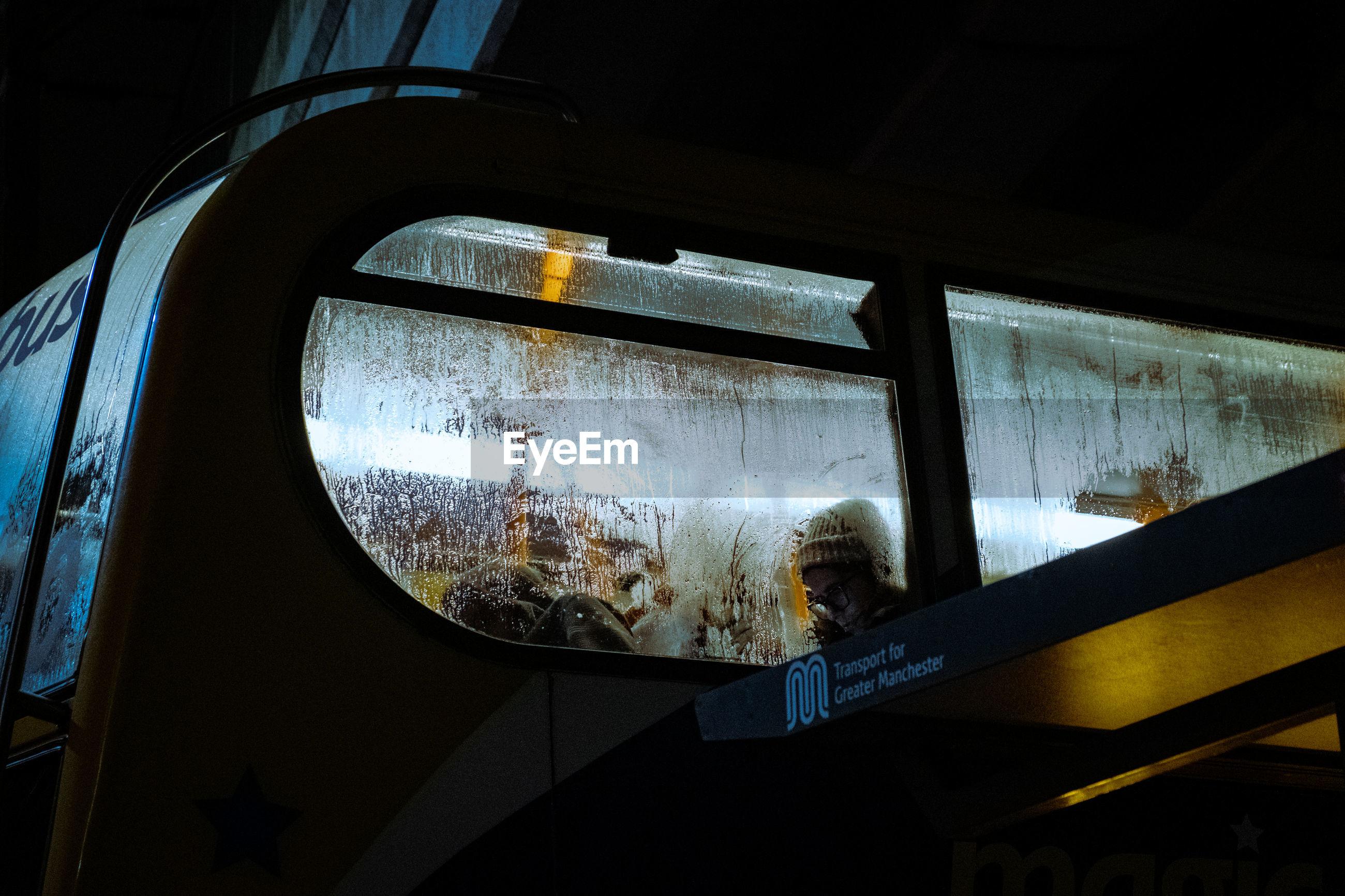 REFLECTION OF TRAIN WINDOW IN RAILROAD STATION