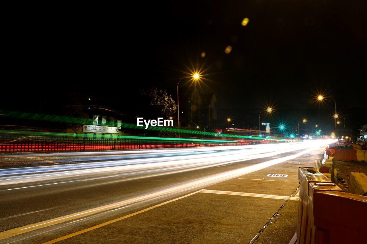speed, light trail, long exposure, motion, illuminated, night, high street, blurred motion, transportation, street light, traffic, road, no people, outdoors, urban scene, city, architecture