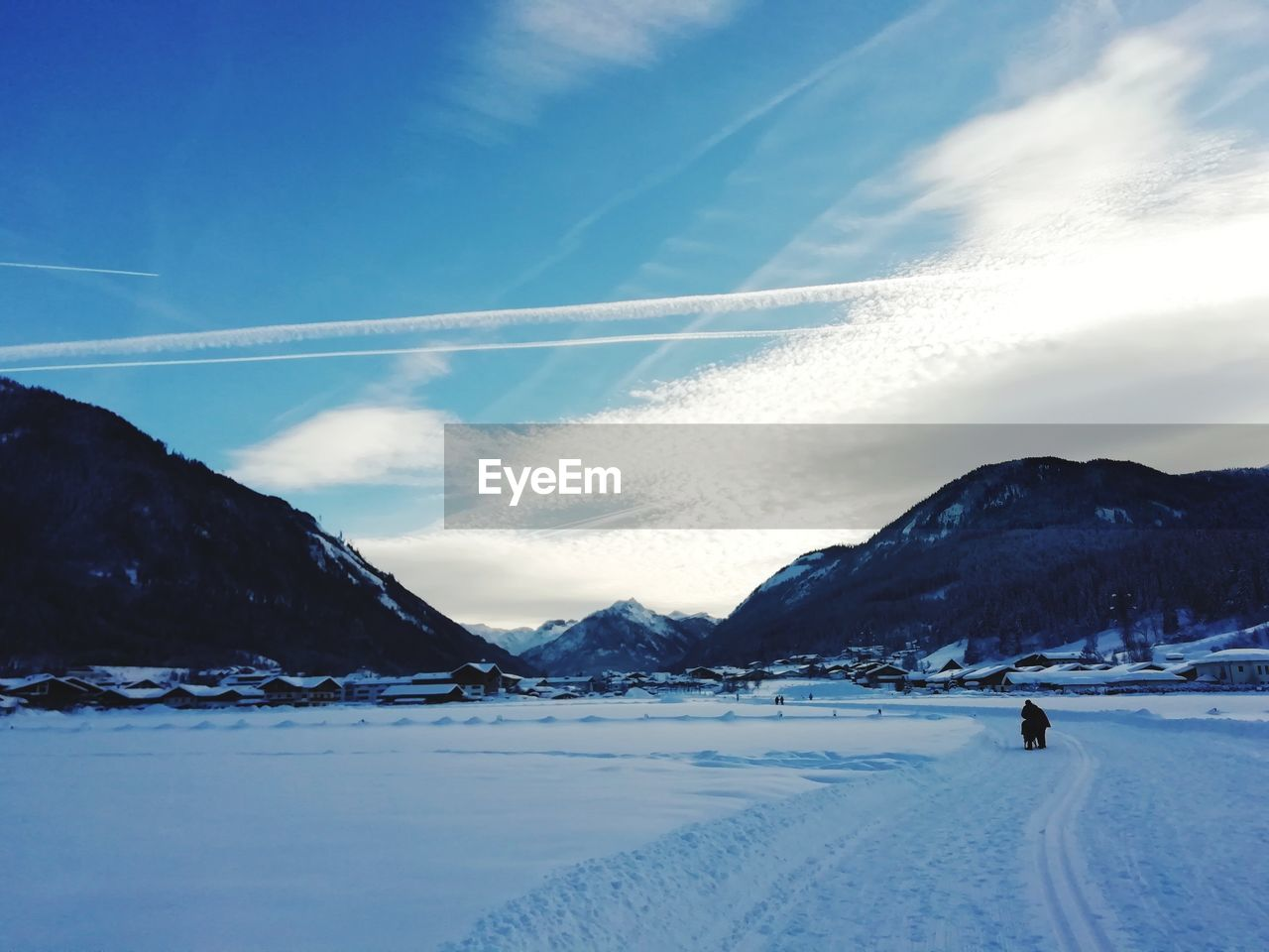 sky, mountain, cold temperature, snow, winter, cloud - sky, scenics - nature, beauty in nature, environment, nature, landscape, non-urban scene, mountain range, day, tranquil scene, tranquility, snowcapped mountain, sport, white color, vapor trail