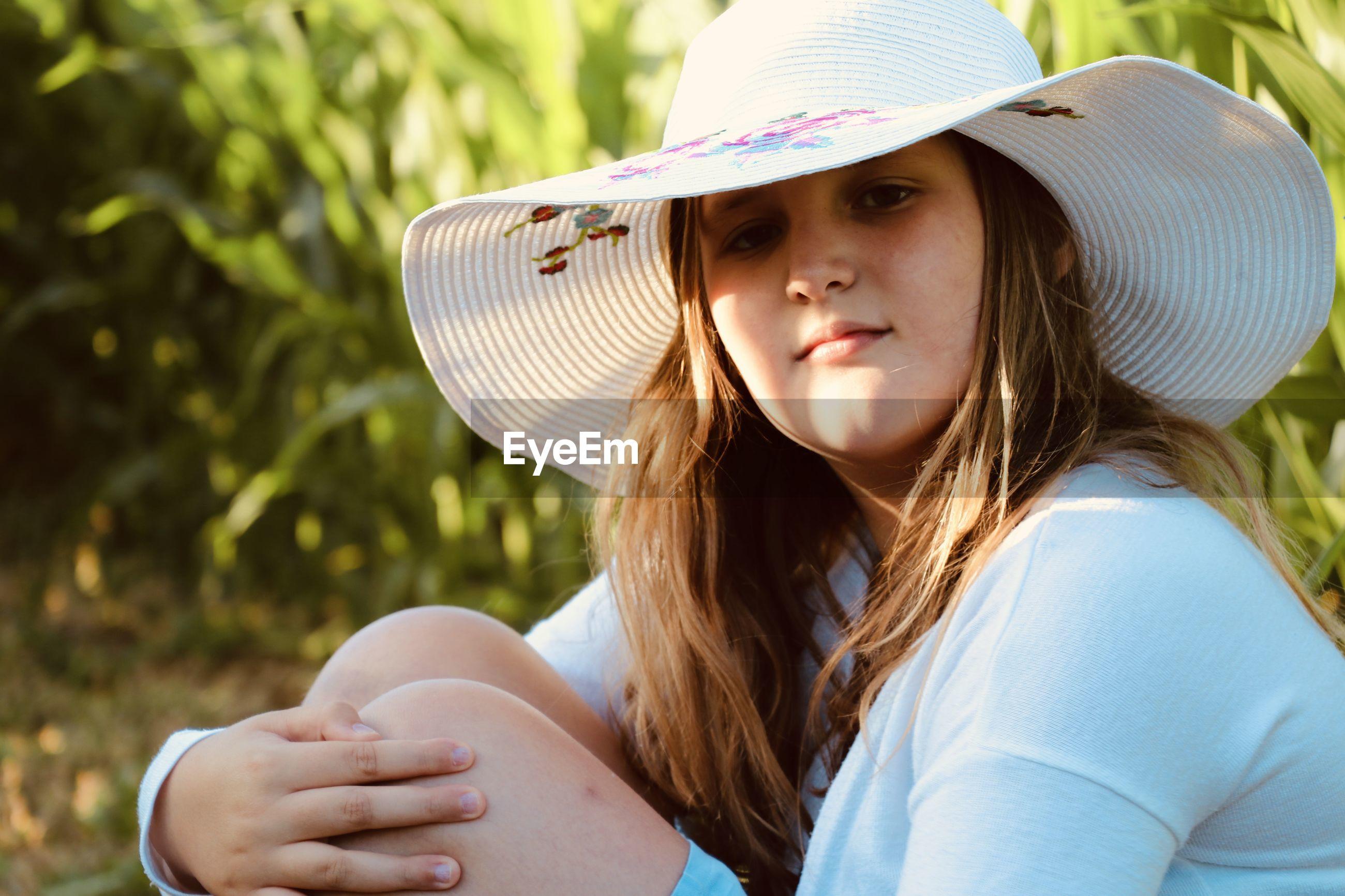 Portrait of teenage girl wearing hat