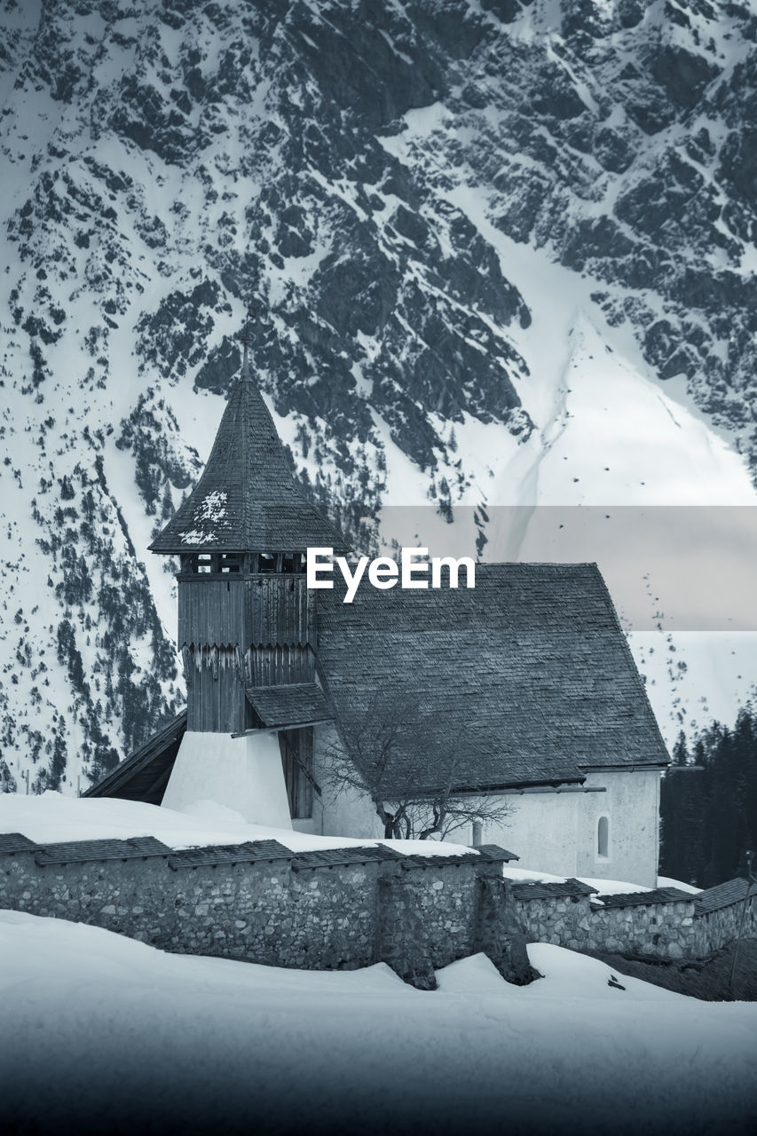 winter, snow, cold temperature, architecture, built structure, building exterior, nature, building, no people, day, religion, place of worship, water, beauty in nature, spirituality, sky, mountain, scenics - nature, belief, outdoors, snowcapped mountain