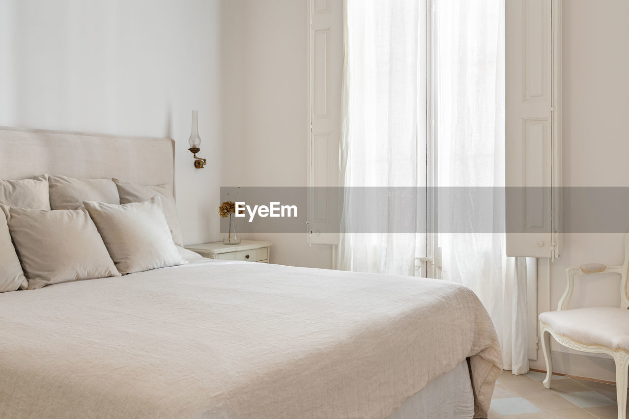 WHITE CURTAIN ON BED