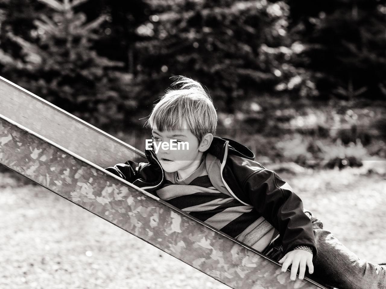 Boy On Slide At Playground