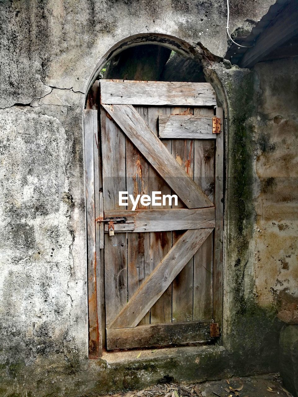 old, no people, architecture, wood - material, built structure, day, weathered, door, entrance, abandoned, wall - building feature, metal, wall, outdoors, window, building exterior, damaged, decline, close-up, deterioration, stone wall