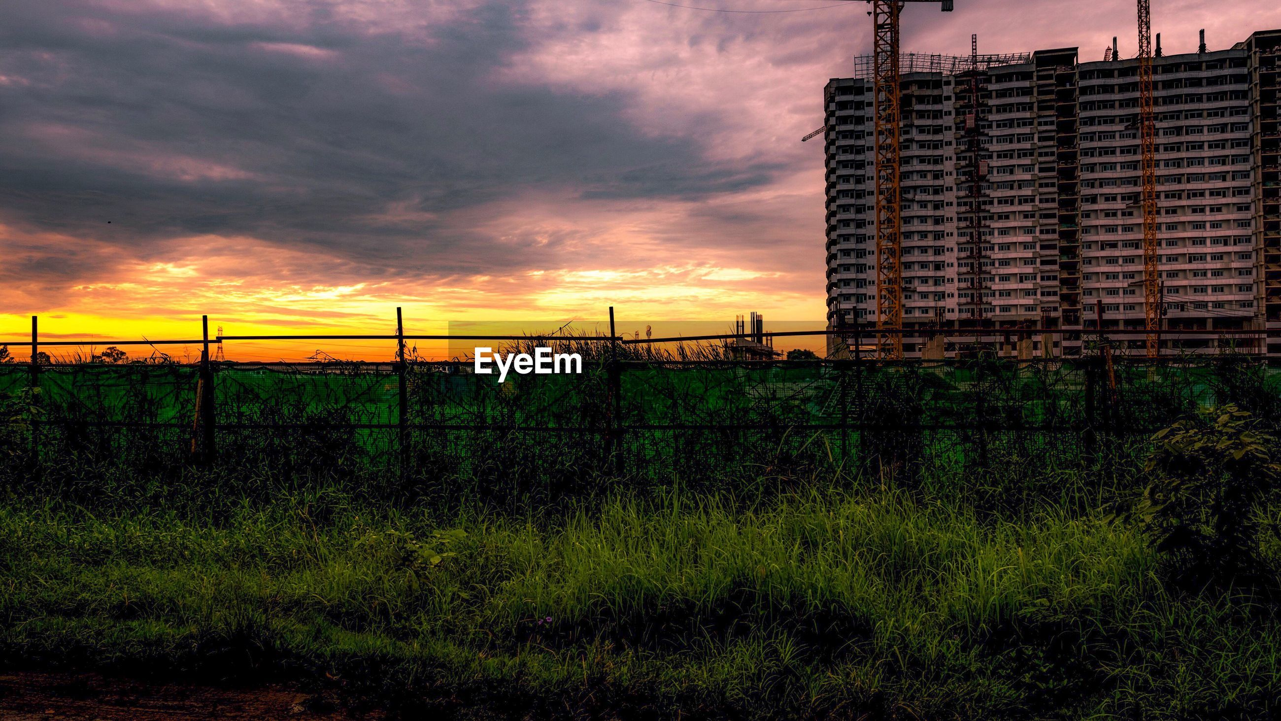 sunset, sky, architecture, built structure, cloud - sky, no people, outdoors, building exterior, growth, grass, nature, day