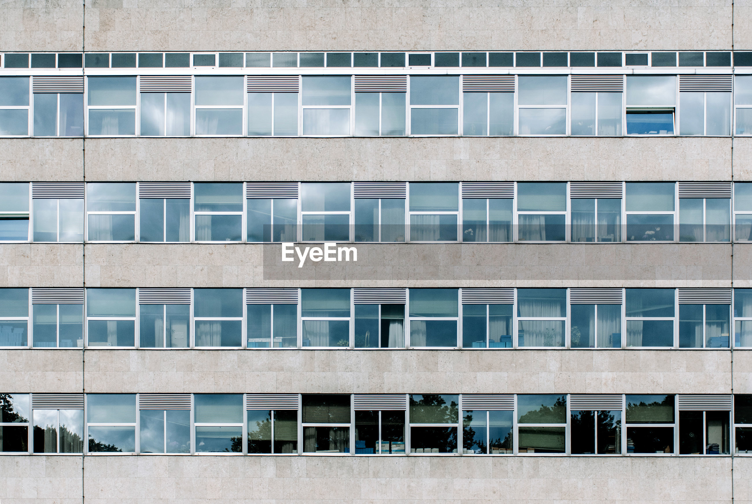 Architecture of office building, exterior, windows, in a row, minimalism, urban.