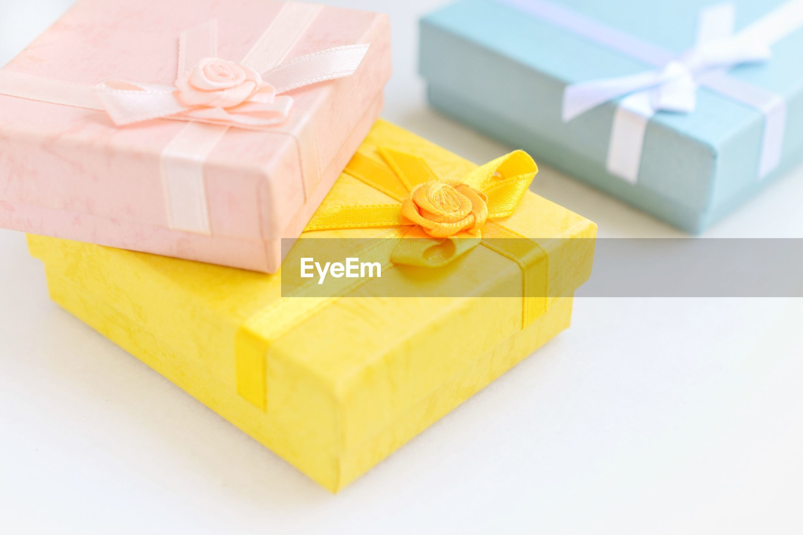 High angle view of gift boxes on gray background