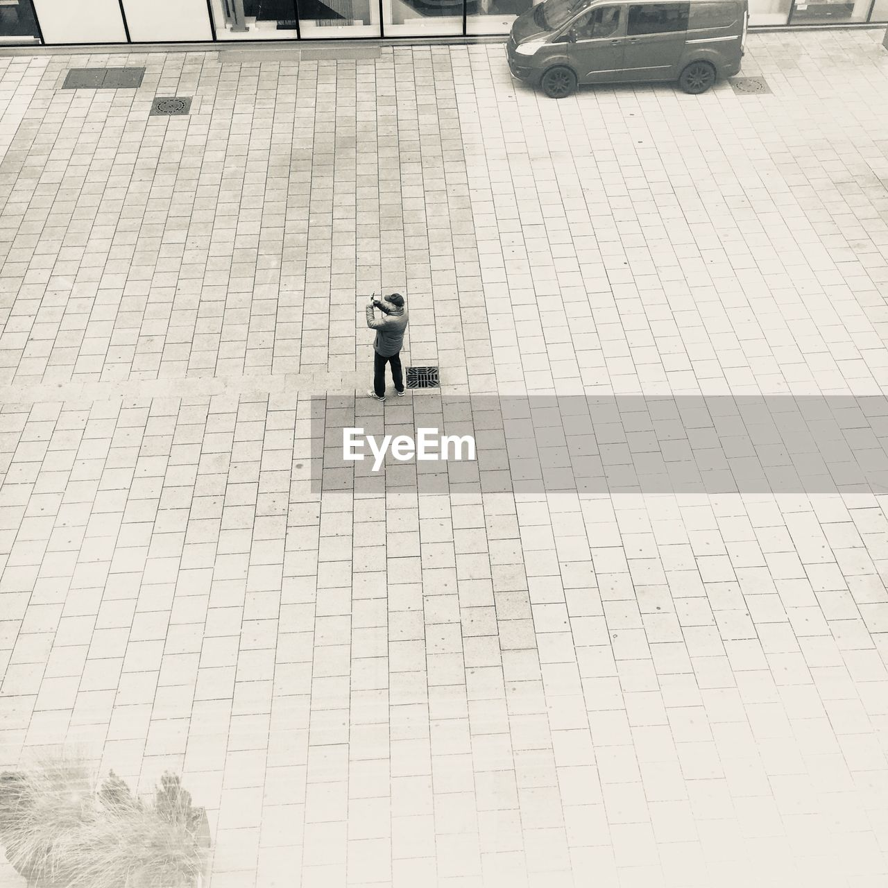 high angle view, outdoors, walking, day, full length, one person, real people, men, one man only, people