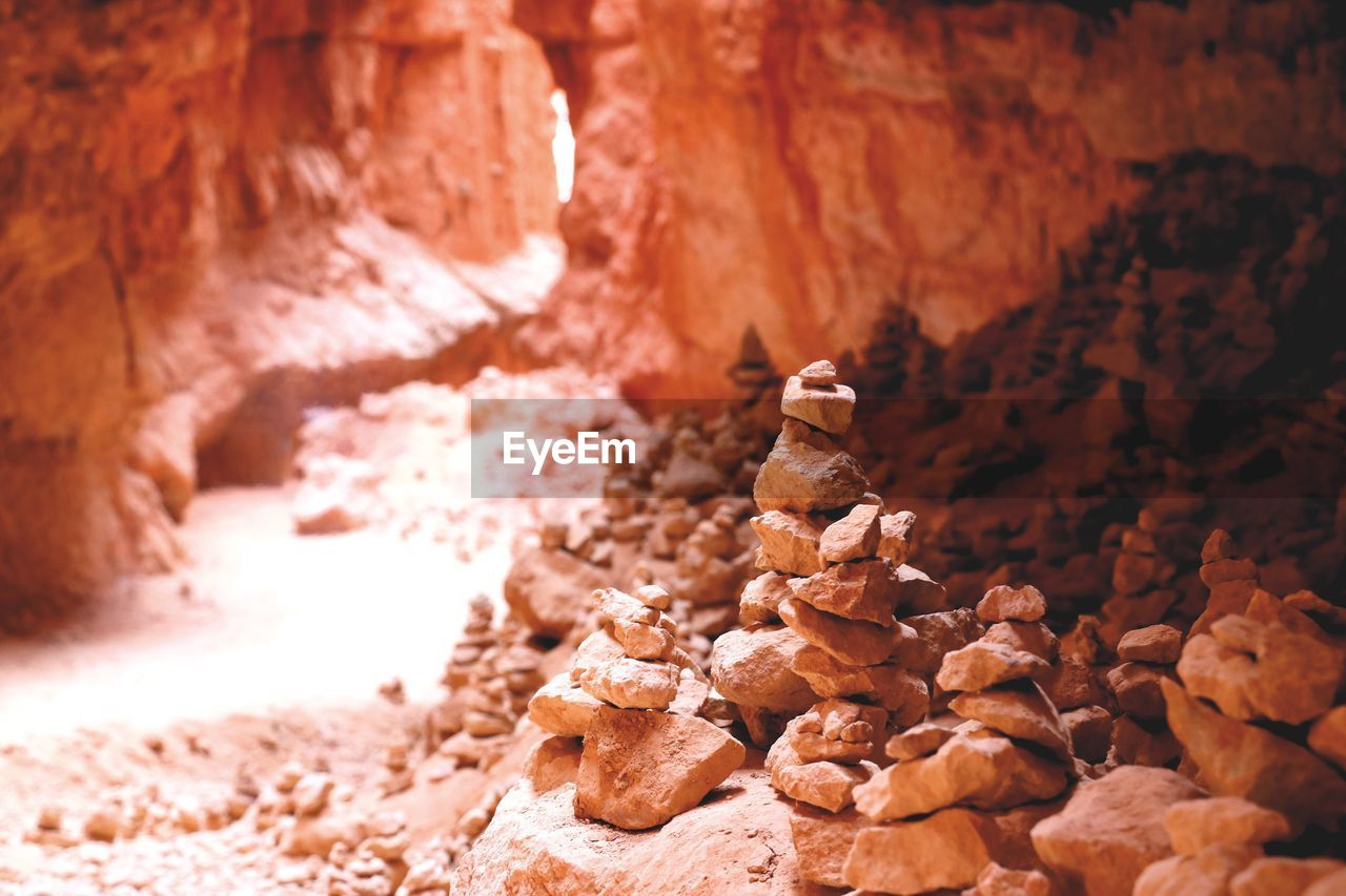 no people, rock, rock - object, rock formation, solid, nature, rough, close-up, physical geography, geology, brown, beauty in nature, selective focus, day, tranquility, textured, focus on foreground, stack, sunlight, indoors, eroded