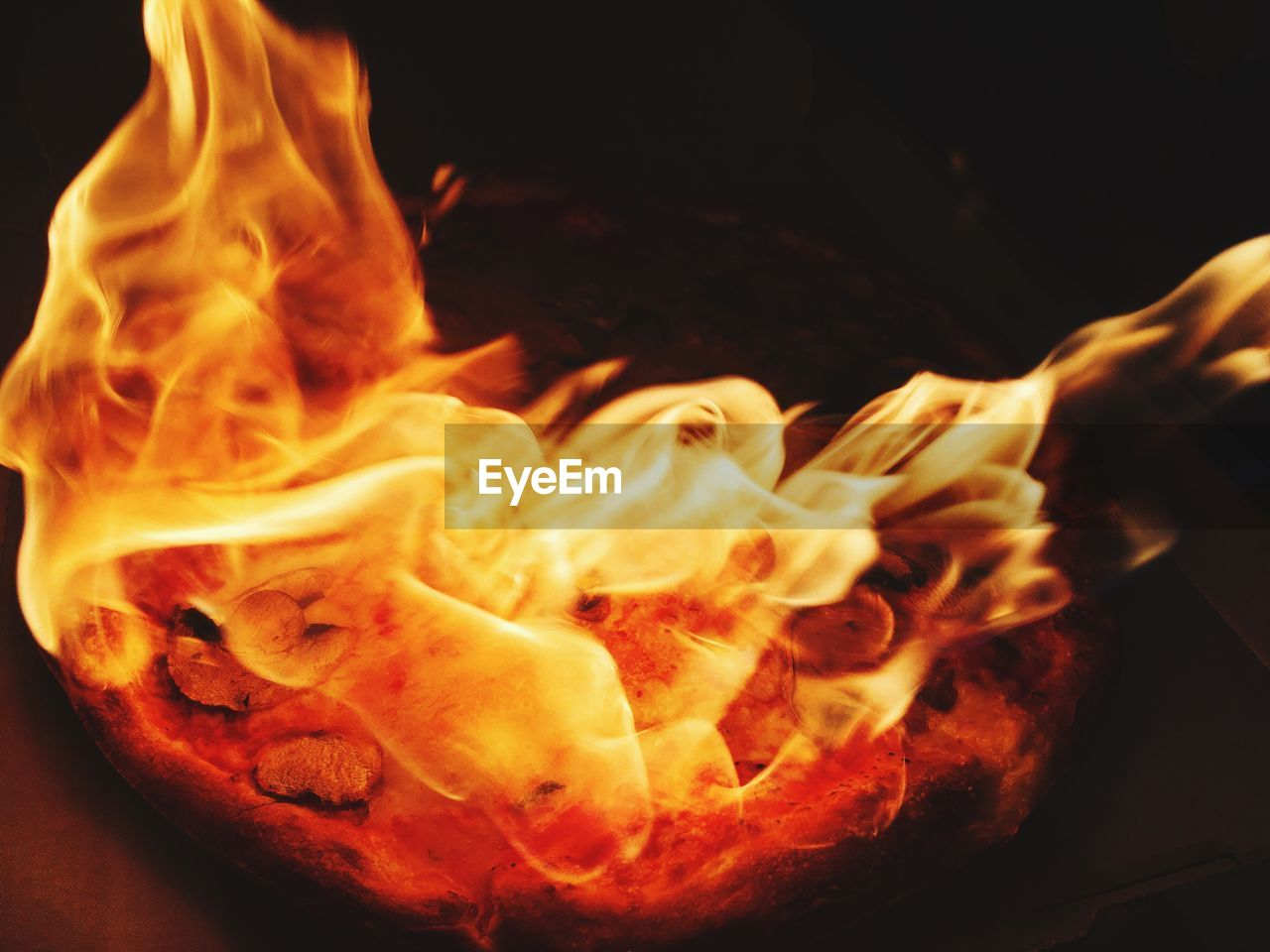 heat - temperature, burning, flame, close-up, food and drink, no people, night, food, black background, freshness, indoors