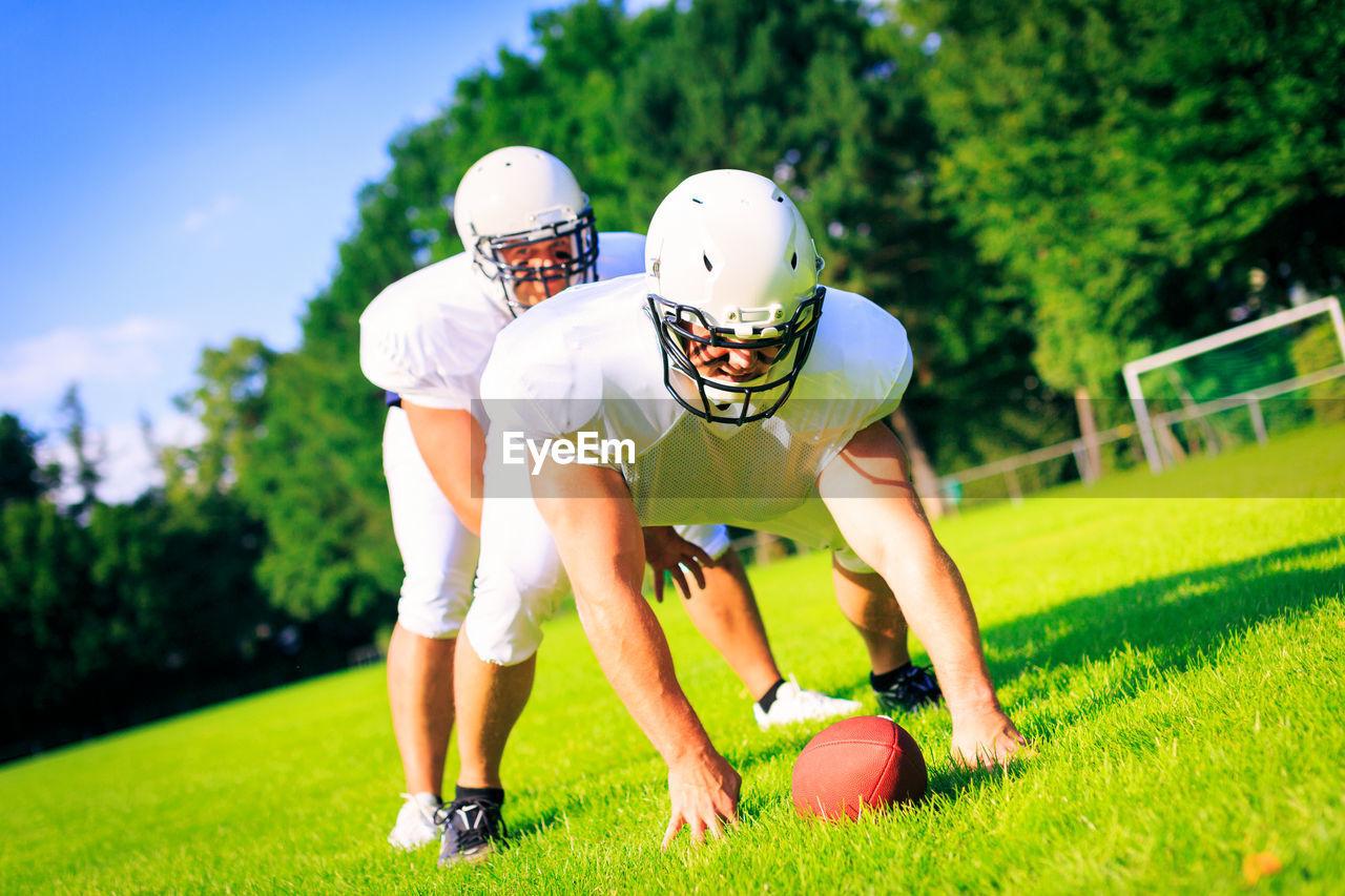 Sportsmen playing on field