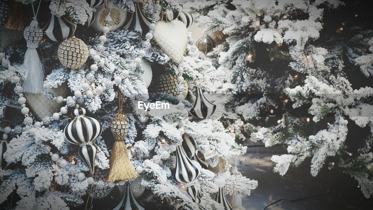 no people, winter, high angle view, variation, cold temperature, day, snow, nature, large group of objects, choice, white color, hanging, celebration, abundance, tree, decoration, indoors, christmas ornament